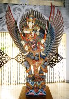 Balinese wooden statue of Vishnu riding Garuda