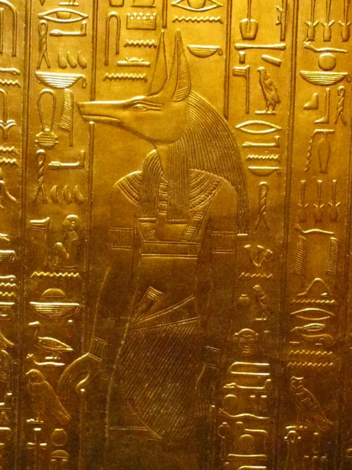 Ancient Egyptian golden frieze of Anubis from the Tomb of Tutankhamun
